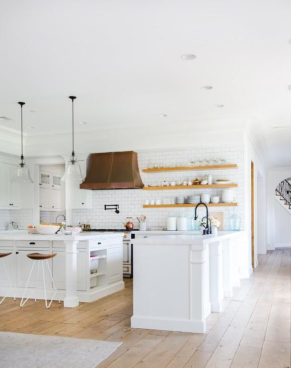 Youll be cooking up a storm in this well appointed white kitchen boasting a