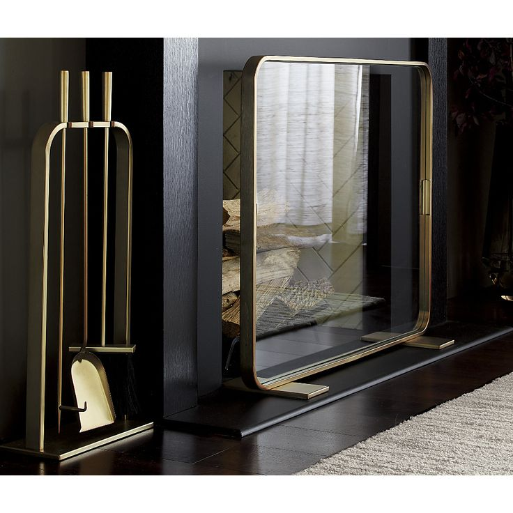 Shop Lana Fireplace Screen. Our contemporary fireplace screen, designed by Ana Reza-Hadden, frames fires in a rounded square of gold-plated iron. Tempered glass screen leaves the view unobstructed while protecting from sparks.