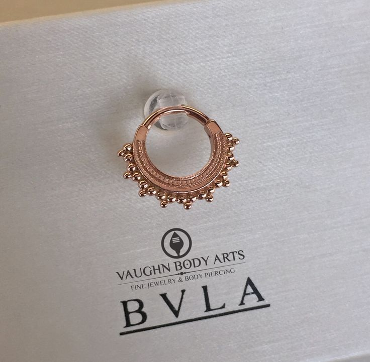 "If you've ever wanted something truly stunning for your septum or daith piercing…..    Take a look at this Rose Gold ""Afghan"" clicker we just got in from BVLA.   @vaughnbodyarts Monterey, CA"
