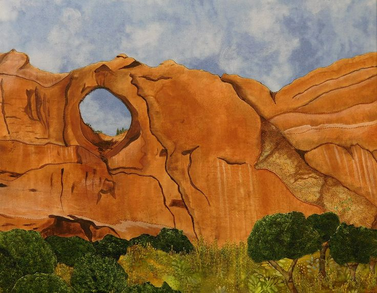"""Window Rock"" - an original signed mixed media painting by artist Joyce Cozby, painted, embroidered and appliqued Arizona southwestern fine art, red rocks, desert, high country, one of a kind. Window Rock is a mixed media painting measuring 22 x 18. Red rock and the foliage are painted, embroidered and appliqued to the blue sky background. Made and shipped by the artist."