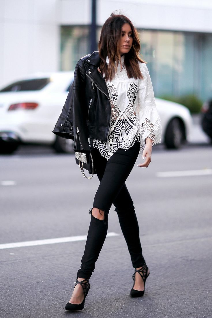 black leather jacket, white lace top and black distressed jeans