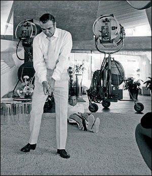 "Connery practicing his golf stance between scenes in Las Vegas for ""Diamonds Are Forever"" (1971). Photo part of the ""A Day Out With Sean Connery"" collection by Terry O'Neill."