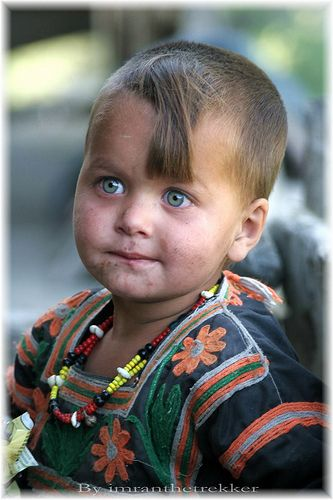A child of the Kalash people.  The Kalash live in the Hindu Kush mountain range and may be descended from Alexander the Great's army.  They practice a polytheistic religion, allow men and women to mix freely, and speak a language related to Greek, things which make the Kalash very different from their Muslim neighbors.
