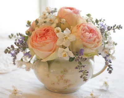 Beautiful arrangement!! (sit a flower frog inside a sugar bowl to keep flowers in place)  Sweet bouquet