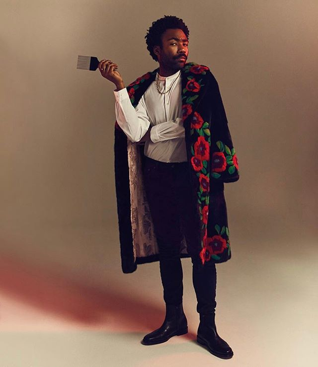 There is no future. There is no past. There is only Donald Glover rocking this look. Coat by @gucci; shirt by @cosstores; chain and ring by @cartier; jeans by @Ksubi from @barneysny. See more at the link in our bio. : Joe Pugliese | @joepug