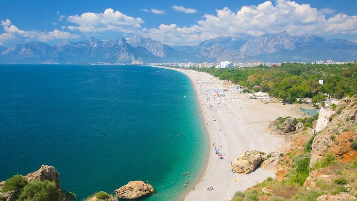 Konyaalti Beach, Antalya - This amazing beach is one of the two main beaches of Antalya. Its golden sands stretch 7 km from the cliffs over to the Beydaglari mountains.