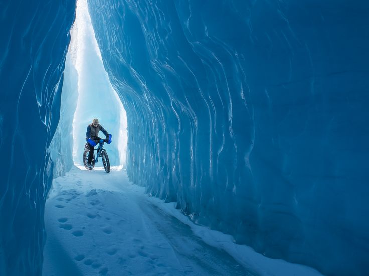 Biking through an ice cave, Knik Glacier, Alaska