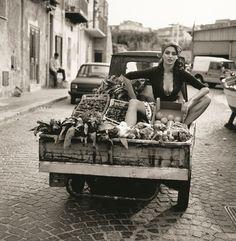 Catrinel Menghia for A Sicilian Adventure Michel Perez set in the 1960's