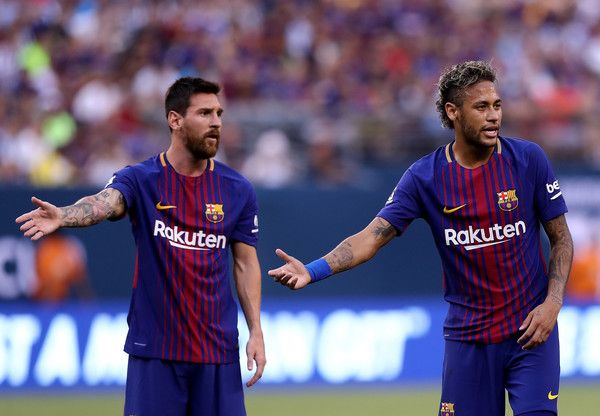 Lionel Messi #10 and Neymar #11 of Barcelona react to the way Juventus lined up for a kick in the first half during the International Champions Cup 2017  on July 22, 2017 at MetLife Stadium in East Rutherford, New Jersey.