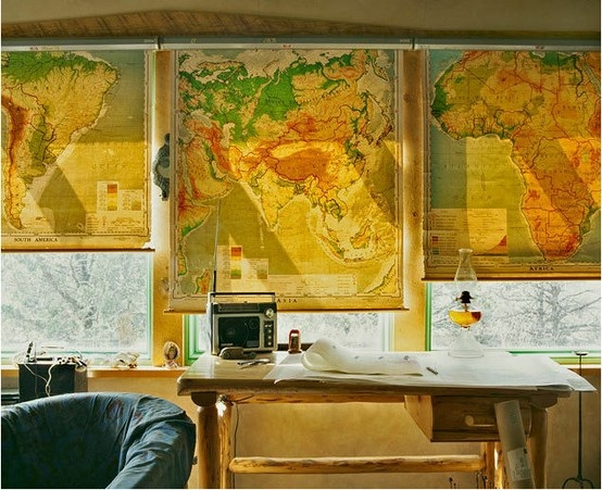 what a great idea!  using pull down maps as blinds!
