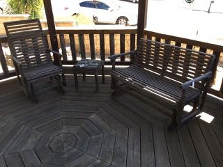 WOOD GLIDING PATIO FURNITURE SOLD BY THE PIECE. INCLUDES ROCKER, BENCH AND TWO TABLES.