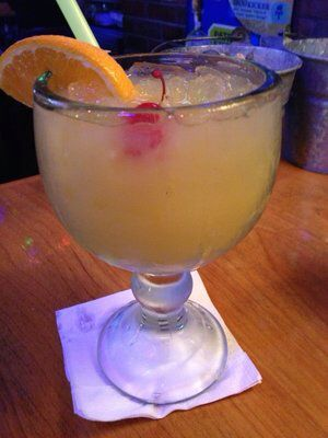 JAMAICAN COWBOY MARGARITA- 1 oz unsweetened pineapple juice 1 oz unsweetened orange juice 1 oz margarita mix 1/2 oz peach schnapps 1 oz coconut rum 1 oz gold tequila