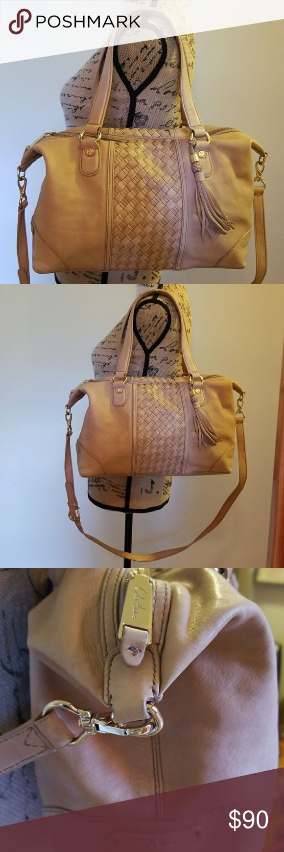 Cole Haan purse Shoulder bag but also comes with straps  Slight signs of wear on the bottom .. See last picture   Inside is in perfect condition! Cole Haan Bags