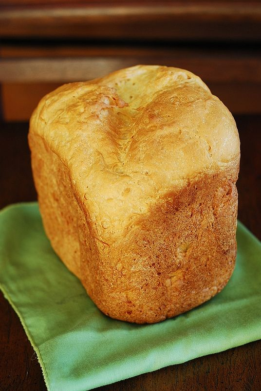 How to make basic white bread in a bread machine less dense - use honey in place of sugar and butter in place of oil.