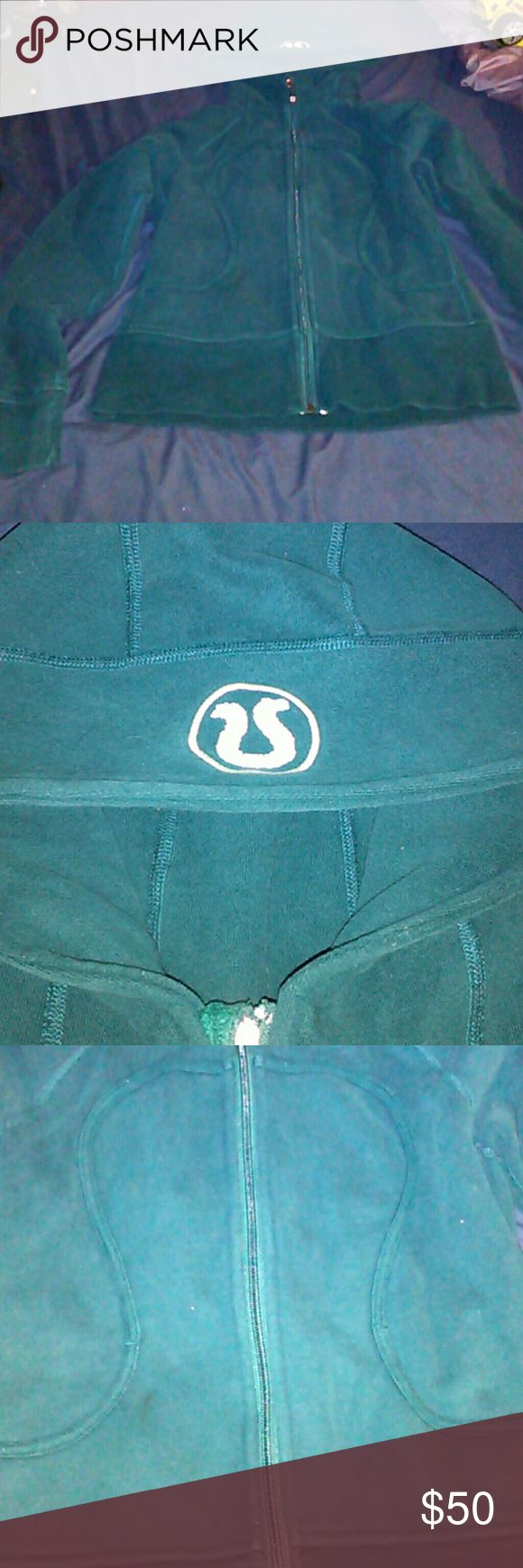 Lululemon athletica  dark green hoodie Very good condition, thick warm hoodie. The hood has a white lulu lemon design has pictured. lululemon athletica Jackets & Coats