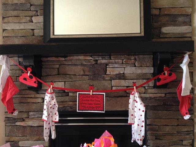 Baby clothes clothesline, makes a cute decoration, and then the mommy to be gets all the cute clothes!