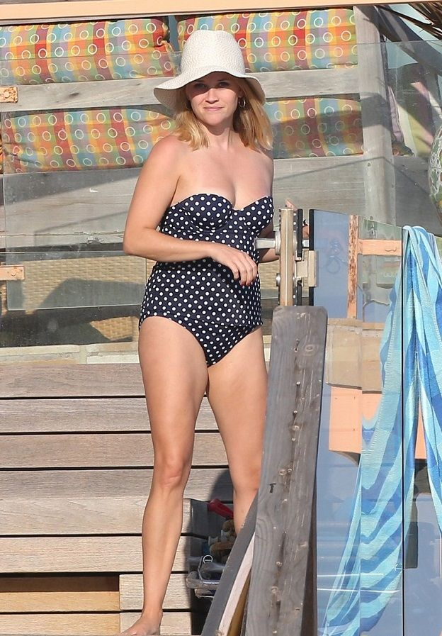Reese Witherspoon in a polka dot swimsuit in Malibu