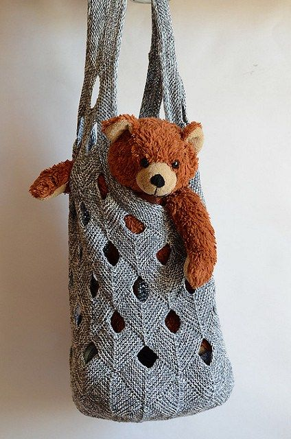 """Knitting pattern for Net Duffle Bag tote - Vivian Høxbro's Net Duffle Bag has a sturdy mesh-like texture formed by joining incomplete mitered squares. 28-1⁄4"""" circumference and 21-1⁄4"""" long, with 2"""" edging at top"""