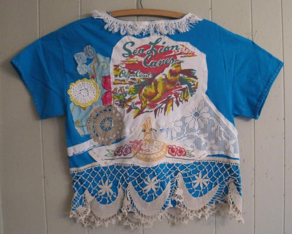 My Bonny Altered T shirt AQUARIUM of the PACIFIC; sea otters & sea lions many fabrics collaged; lots of elements old and new buttons crochet antique yoyos embroidery  bark cloth fringe lace map of Coast  Sea Lion Caves textile floral