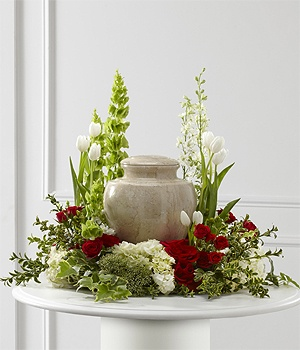This Cremation Wreath is Designed to Enhance the Urn and Say We Will Miss You. This Design Features Groupings of Flowers including Roses, Tulips, Bells, Hydrangea, Hypericum Berries Accented with Fancy Foliages.