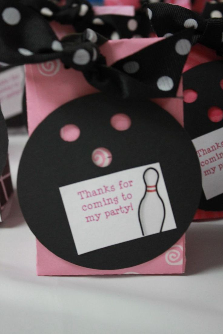 Favor Boxes Closeup. bowling ball - black circle with 3 hole punches