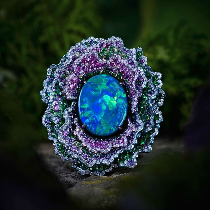 Chopard - Fleurs d'Opales ring in white gold and titanium featuring a black opal and multicoloured gemstones.