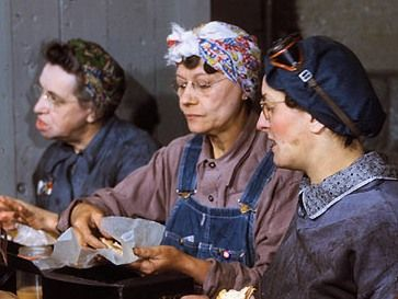 Detail of photo of women employed as roundhouse wipers having lunch, Chicago & North Western R.R., Clinton, Iowa. Photo by Jack Delano, April 1943. - WWII propaganda photo USA, women war workers, railroad, rail road, train