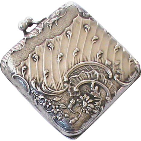 Art Nouveau solid silver compact with a beveled mirror inside and original powder puff.