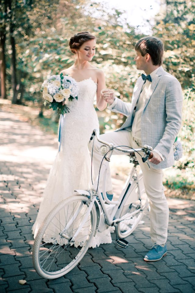 Wedding portraits with a bike | Anastasiya Belik Photography | http://burnettsboards.com/2013/12/powder-blue-white-wedding/