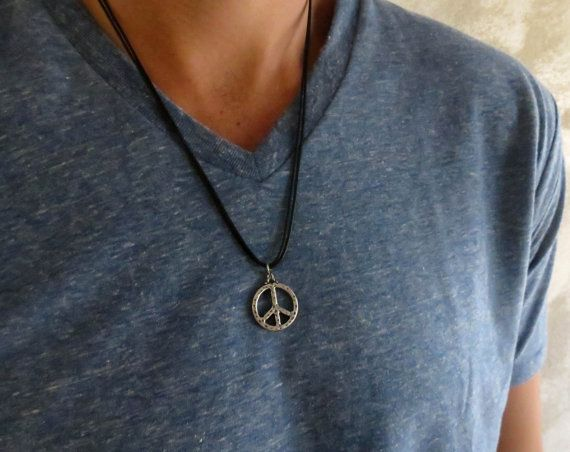 "Men's Necklace - Men's Peace Sign Necklace - Men's Silver Necklace - Mens Jewelry - Necklaces For Men - Jewelry For Men - Gift for Him  Looking for a gift for your man? You've found the perfect item for this!   The simple and beautiful necklace features black wax wire chain with a silver plated peace sign pendant.  Length: 20"" (50 cm). $22"