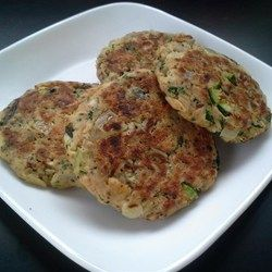 Easy salmon patties are pan-fried and served alongside a simple sour cream and dill sauce perfect for appetizers or a simple main dish.