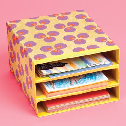 Take three cereal boxes, tape and wrap them together and... voila! paper storage and possibly even mailboxes! Neat idea.