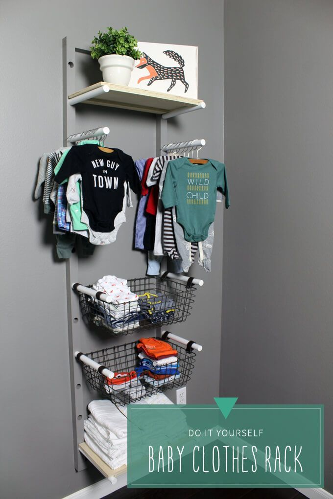 Create a vertical baby clothes rack to hang on the wall to store and organize baby clothes in a nursery without a closet.