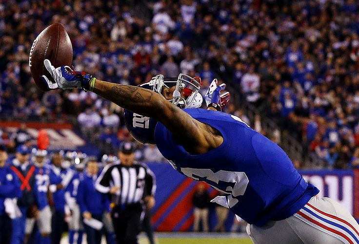 If you haven't seen Odell Beckham Jr.'s insane catch by now, watch it here, but also check out these photos from Al Bello of Getty Images. The details of the whole highlight are beautiful, like Cowboys corner Brandon Carr tumbling out of bounds, the flag on the eventually declined penalty, and the fact that Beckham initially caught that football with three damn fingers..
