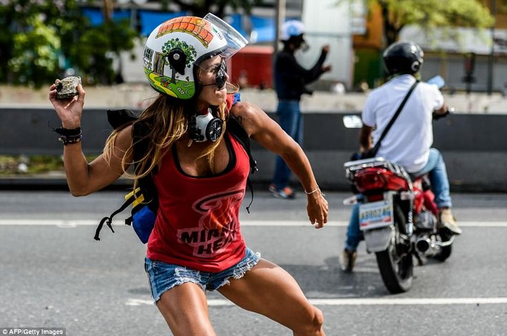Protesters clashed with police in Caracas, the Venezuelan capital, during May Day marches as President Nicholas Maduro announced plans to have an unelected body of workers redraft the country's constitution