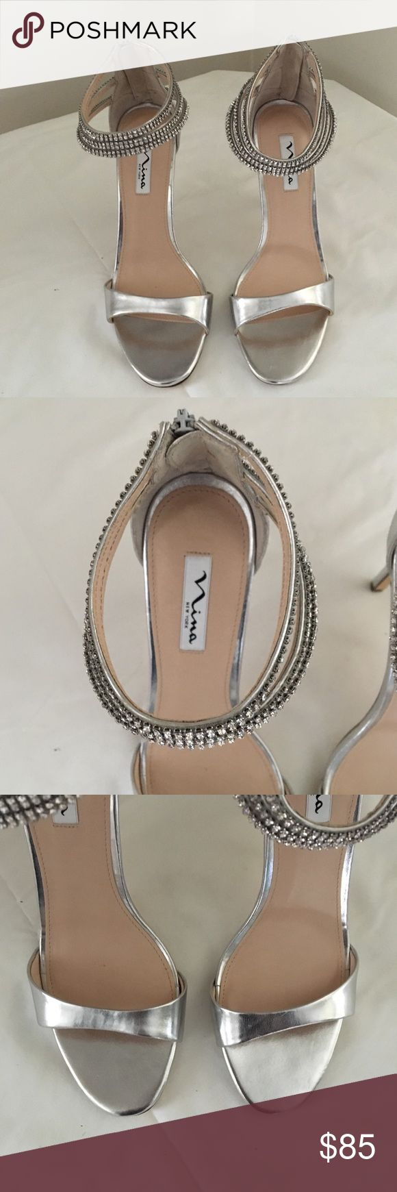 """Nina Women's Catessa Dress Sandal Beautiful silver sandals with silver ankle straps. The perfect shoes for any occasion. Size 10. Leather sole. Heel measures approximately 4"""". Elegant dress sandal featuring zip-up heel cup with trio of rhinestone ankle straps. Nina Shoes Sandals"""
