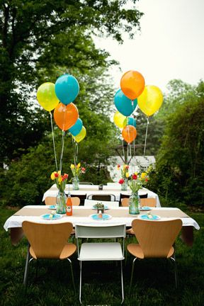 This on tables with Hot pink and light pink balloons for center