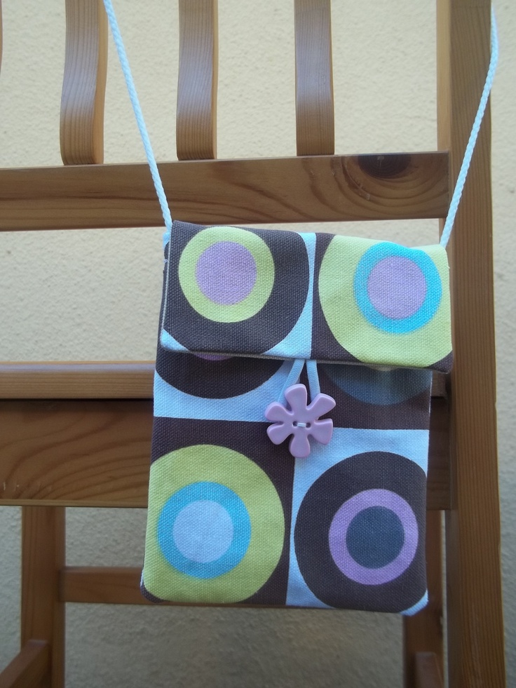 First attempt of making a small bag. Not to be repeated, as my design has flaws. I like the button combined with the circles on the fabric, though.