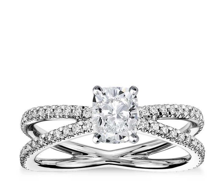Beautifully crafted, this platinum engagement ring features two French pavé-set bands that form a reverse split shank that will enhance the center diamond of your choice.