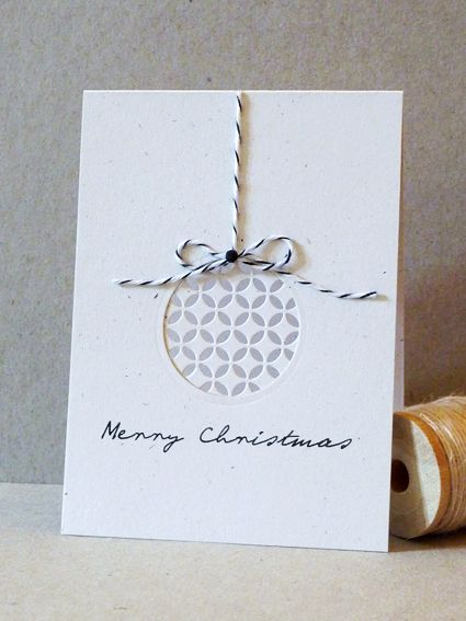 circle die cut negative part with patterned paper in back for ornament; cute