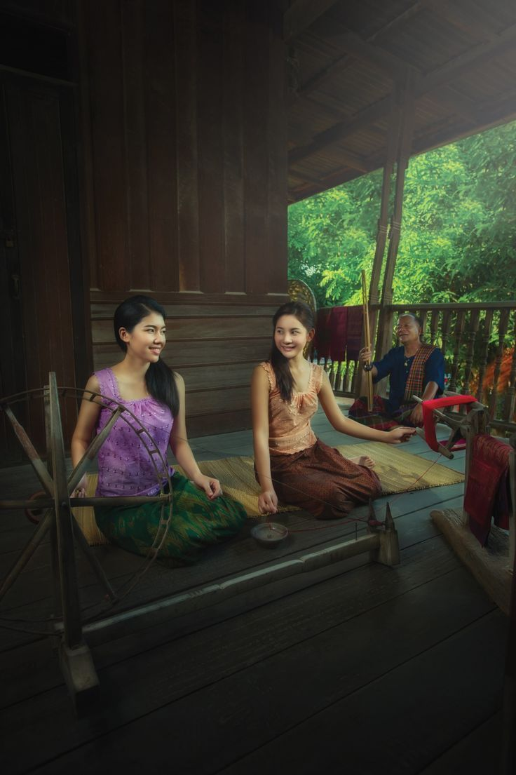 Girls spinning silk. Thai lifestyle