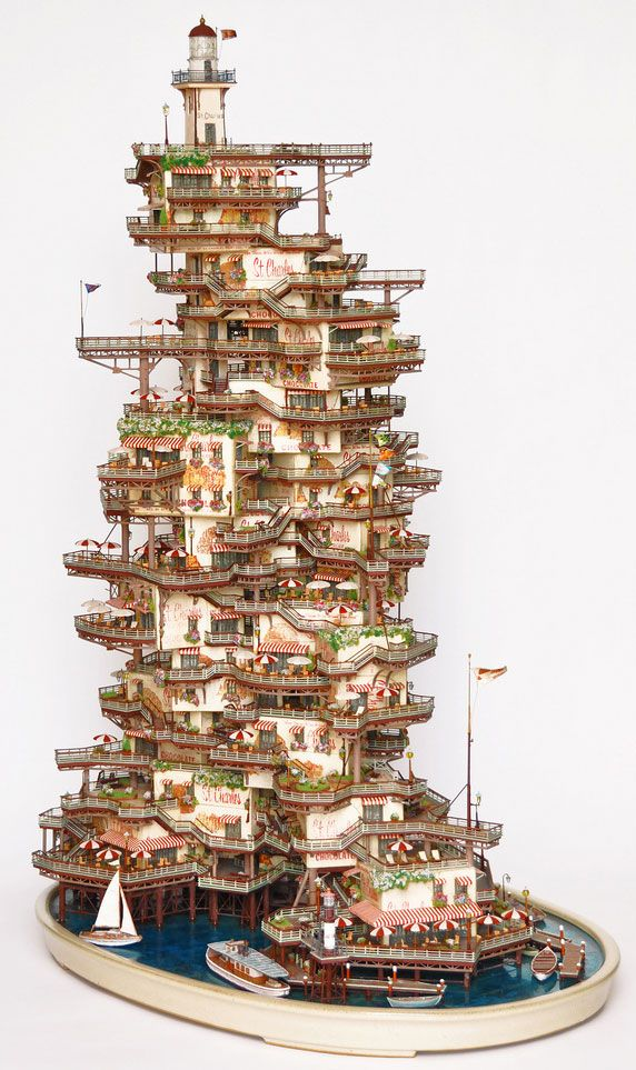 Japanese artist Takanori Aiba creates astoundingly detailed sculptures of tiny buildings. The sculptures are inspired by the Japanese art forms of bonsai (miniature trees) and suiseki (stone appreciation). For more photos see Aiba's Flickr site.