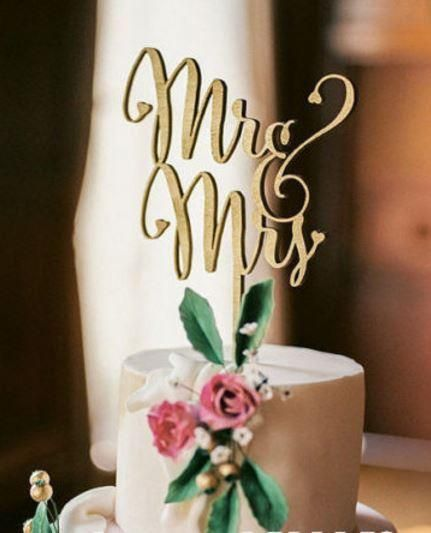 """Mr. & Mrs."" laser cut natural wood cake topper can be used as is for a nature or rustic theme, or can be painted any color to match any theme or décor."