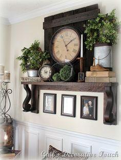 Living Room decor - rustic farmhouse style. Dark wood floating shelf or mantel with reclaimed barn wood, vintage decor and clocks.