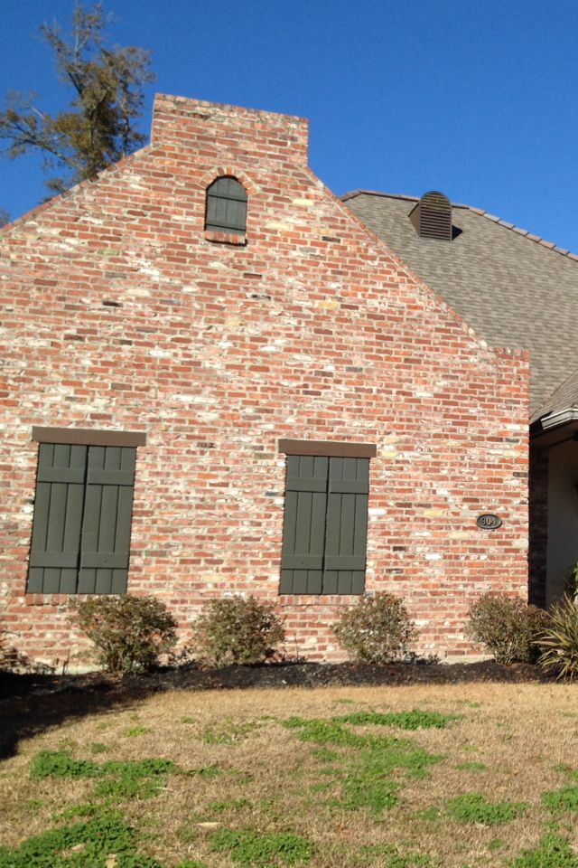 Old St Louis used brick with tan weatherwood shingles. Painting shutters Sherwin Williams Shade Grown 6188