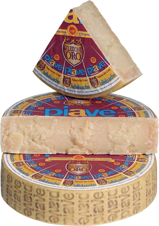 Piave Vecchio Selezione Oro is an Italian cow's milk cheese named after a river by the same name. The only authentic Piave Vecchio Selezione Oro is produced in the Dolomites area of Belluno province of Veneto. After has matured variety it is offered only after it reaches its full potential at one year of aging. It is a hard, grainy and crumbly with a flavour that is mild and never sharp. With longer aging it cultivates a very intense, fruity flavour with an enduring.