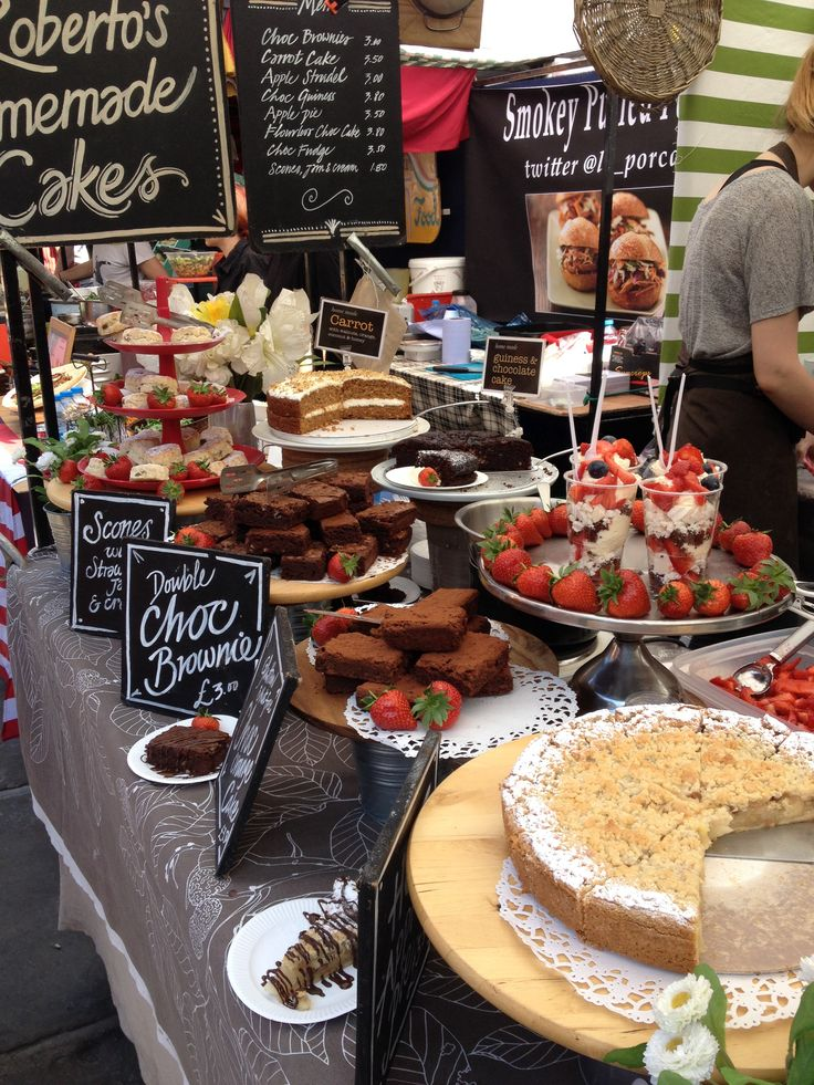 Cake stall at Camden Lock Market, London  Love the use of strawberries for extra colour!