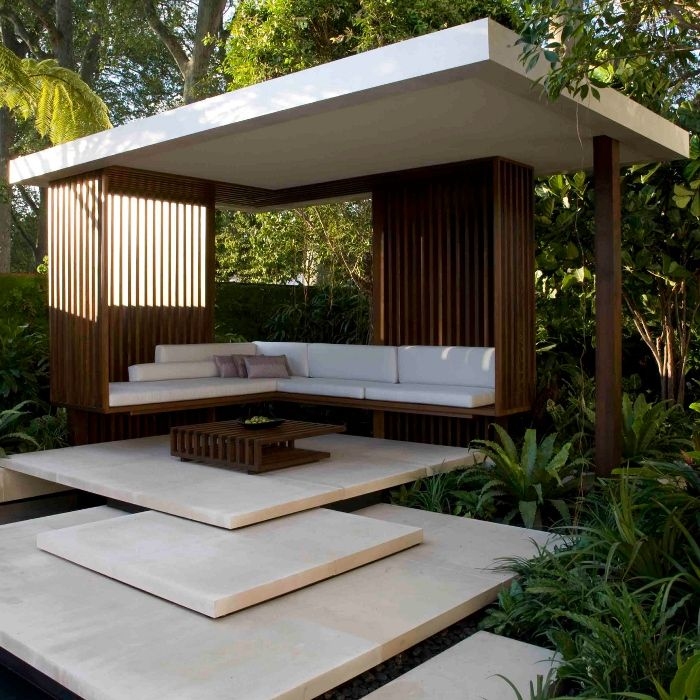 Stone steps which lead to this modern gazebo set within for Contemporary garden design ideas
