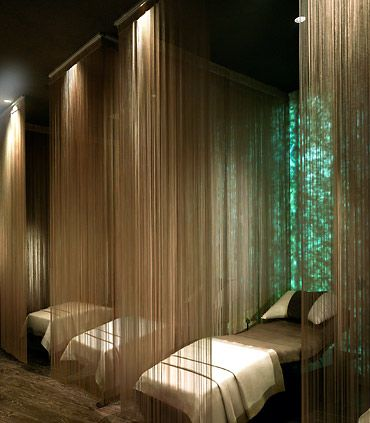 These string screens work beautifully, adding a delicate layer of privacy and some fabulous texture to the room's scheme.