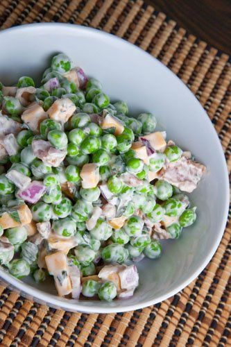 Fresh Pea Salad... 2 cup peas 2 strips bacon (cooked and crumbled) 1/4 cup cheddar cheese (cubed) 2 tablespoons red onion (chopped) 3 tablespoons mayonnaise 1 tablespoon sour cream 2 tablespoons mint (chopped) 1 pinch of cayenne Mix everything and chill in the fridge.